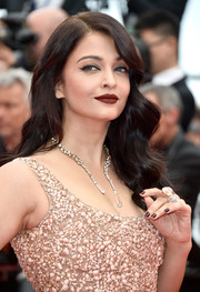 Aishwarya Rai finished off her look with an oxblood lip.