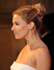 Sienna Miller styled her look with a pair of diamond drop earrings by De Beers.