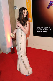 Anya Taylor-Joy accessorized with a cream hard-case clutch by Yliana Yepez at the 2015 BFI London Film Festival Awards.