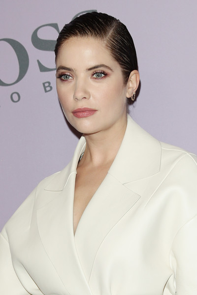 Ashley Benson styled her hair into a slick side-parted chignon for the Boss Fall 2020 show.