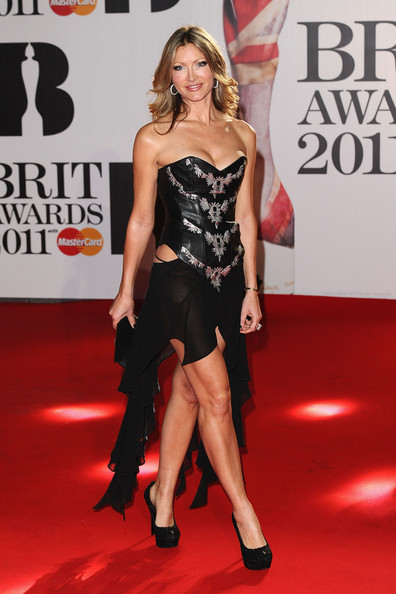 Caprice donned a daring corset-style cut-out dress for The BRIT Awards 2011 in London.