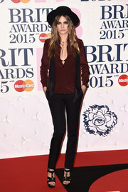 Cara Delevingne chose a gorgeous deep red blouse to add a pop of color to her look at the BRIT Awards.