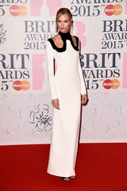 Karlie Kloss arrived at the BRIT Awards in a gorgeous white gown with unique cutout shoulders.