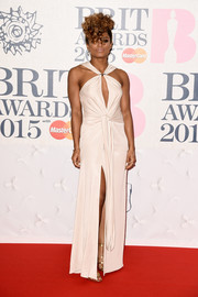 Fleur East chose a stunning halter gown for the BRIT Awards with a keyhole detail and a high slit.