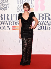 Noomi Rapace arrived at the BRIT Awards in a gothic inspired black lace gown.