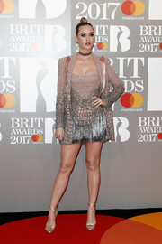 Katy Perry dazzled in a mauve and silver jacket and mini dress set by Atelier Versace at the Brit Awards.