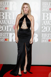 Ellie Goulding got majorly vampy for the Brit Awards in a black Philipp Plein halter gown with a chain-embellished cutout and a high front slit.