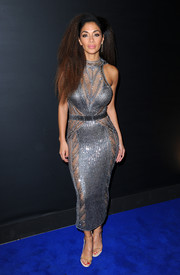 Nicole Scherzinger turned up the heat in a skintight silver chainmail dress by Julien Macdonald at the Universal Music party for the Brit Awards.
