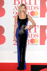 Hailey Baldwin went for edgy glamour in a blue and black sequin column dress by Ralph Lauren at the 2018 Brit Awards.