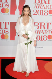 Perrie Edwards hovered between angelic and vampy in a sheer white boho gown at the 2018 Brit Awards.