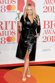 Emma Bunton was cool and edgy in a black vinyl trenchcoat by The Kooples at the 2018 Brit Awards.