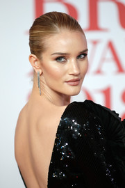 Rosie Huntington-Whiteley styled her hair into a croydon facelift for the 2018 Brit Awards.