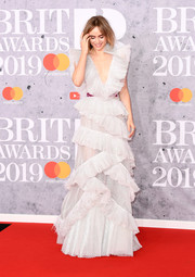 Suki Waterhouse dolled up in a white ruffle gown by Rami Kadi Couture for the 2019 Brit Awards.