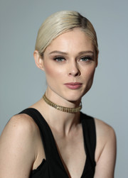 Coco Rocha added a bit of shimmer with a gold choker.
