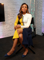 Naomie Harris showed off her cheery winter style with this yellow, white, and blue lace-up sweater dress by Cédric Charlier while attending her BUILD live interview.