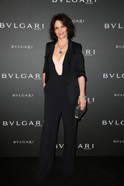 Juliette Binoche toned down the sexiness with a black tux jacket.
