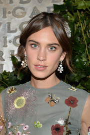 Alexa Chung adorned her romantic 'do with an opulent diamond brooch, also by Bulgari.