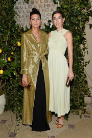 Giovanna Battaglia matched her outfit with a gold box clutch by Sara Battaglia.