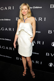 Naomi Watts went for a simple white dress with a frill detail for the BVLGARI And Save The Children Pre-Oscar Event.