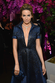 Camilla Belle paired an elegant navy Louboutin clutch with a plunging cocktail dress for the Bulgari and Save the Children pre-Oscar event.