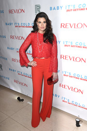 Idina Menzel finished off her all-red ensemble with a hard-case clutch.