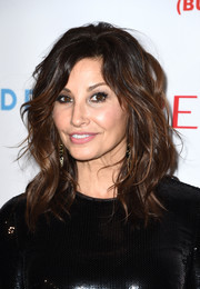 Gina Gershon looked fabulous with her perfectly styled waves at the 'Baby It's Cold Outside' concert.