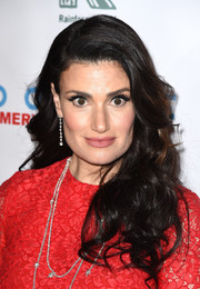 Idina Menzel looked oh-so-glam with her luxuriant curls at the 'Baby It's Cold Outside' concert.