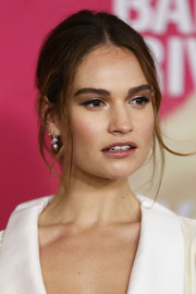 Lily James accessorized with a classic pair of pearl drop earrings.