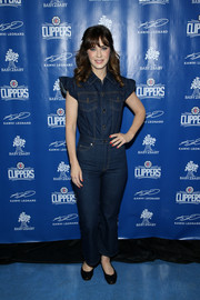 Zooey Deschanel attended the celebration of Baby2Baby's donation of one million backpacks wearing a cute denim jumpsuit with ruffle cap sleeves.
