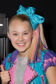 JoJo Siwa attended the 2018 Teen Choice Awards wearing her signature side ponytail (but of course).