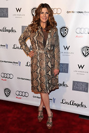 The actress took this look a little too far with a head to toe snakeskin ensemble. The t-strapped snakeskin sandals were fine but the coat needs to go!