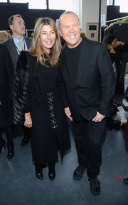 Nina Garcia looked swanky in a fringed black suede jacket with fur sleeves during the Michael Kors fashion show.