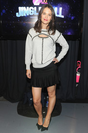 Katie Holmes' fluted black mini skirt and studded sweater were a super-cute pairing.