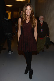 Kelly Bensimon sported a youthful vibe in a maroon fit-and-flare mini dress during Jingle Ball.