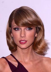Taylor Swift styled her short hair with curly ends and side-swept bangs for Z100's Jingle Ball.