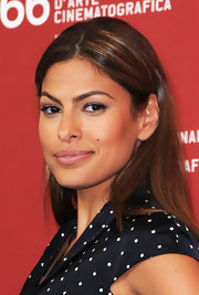 "Eva Mendes showed off her sleek center part hair while at the movie premiere of ""Bad Lieutenant""."