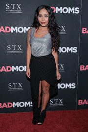 Nicole Polizzi exposed some leg in a black high-low skirt.