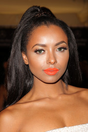 Kat Graham's beauty look totally lit up thanks to that bright orange lip color.