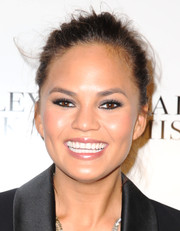 Chrissy Teigen pulled her locks back in a messy updo for the Badgley Mischka fashion show.
