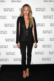 Chrissy Teigen teamed her sultry jacket with a pair of black suede skinnies.