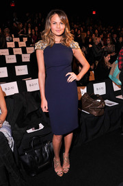 Chrissy Teigen looked flawlessly chic in a navy Badgley Mischka sheath with beaded cap sleeves during the label's fashion show.