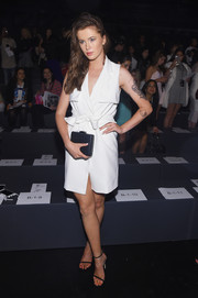 Ireland Baldwin was cool and stylish in a white tux-style wrap dress by Badgley Mischka during the brand's fashion show.