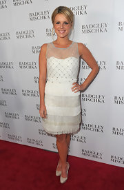 Ali wears a fringed and sparkling cocktail dress in bright white for the Badgley Mischka store launch.