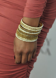 Tamala Jones paired her ruched dress with golden beaded bangles.