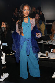 Serayah McNeill turned heads in flared knit overalls by Baja East while attending the brand's fashion show.