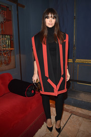 Miroslava Duma couldn't be missed in her oversized red and black Balmain vest at the label's aftershow dinner.