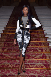 Justine Skye paired her top with a newspaper-print pencil skirt, also by Balmain.