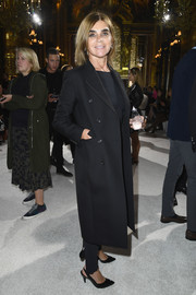 Carine Roitfeld arrived for the Balmain show all bundled up in a black wool coat.