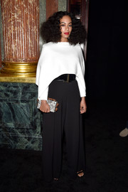 Solange Knowles styled her outfit with a speckled box clutch featuring geometric 3D accents around the edges.