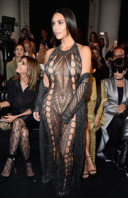 Kim Kardashian commanded stares with this nearly-naked net dress at the Balmain fashion show.